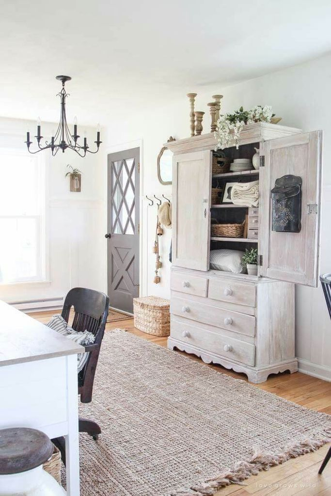 Wooden cupboard in grey combined with wooden floor