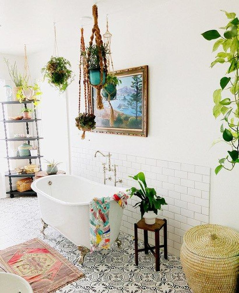 A-bright-boho-bathroom-with-a-mosaic-tile-floor-boho-rattan-basket-to-store-dirty-clothes-to-make-it-look-neat