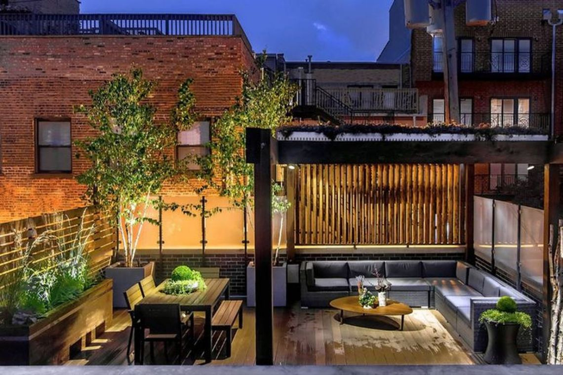 A-cozy-backyard-patio-deck-design-with-added-firing-lights-to-light-up-your-terrace-which-is-placed-on-the-pergola