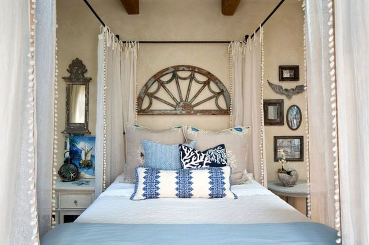 A-simple-bed-with-a-boho-touch-you-can-add-a-white-mosquito-net-to-the-iron-frame-of-your-bed-to-make-you-comfortable-while-sleeping