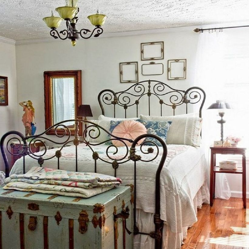 Classic-black-iron-bed-frame-that-creates-a-vintage-bedroom-atmosphere-by-adding-nightstand-to-store-table-lamp-furniture
