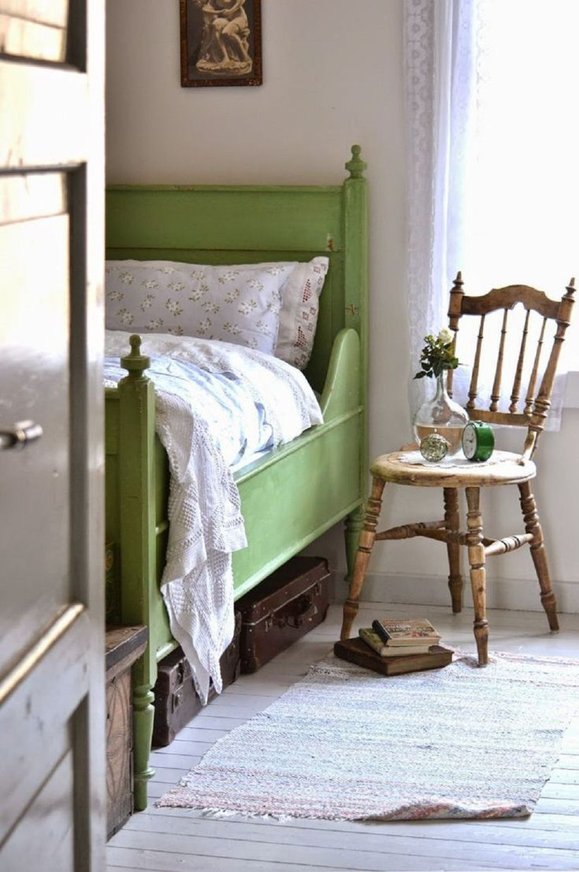 Classic-chair-that-is-used-as-a-night-stand-to-store-house-plant-and-small-clock-to-inspire-your-bedroom-vintage-design