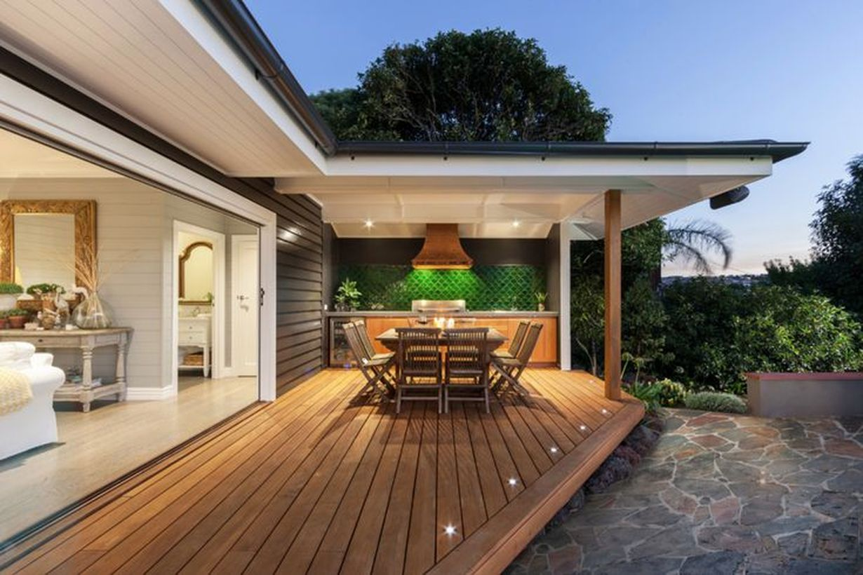 Decorative-lighting-on-backyard-patio-deck-design-with-wooden-dining-table-and-add-decorative-lighting-applied-to-your-patio-floor-to-get-good-light