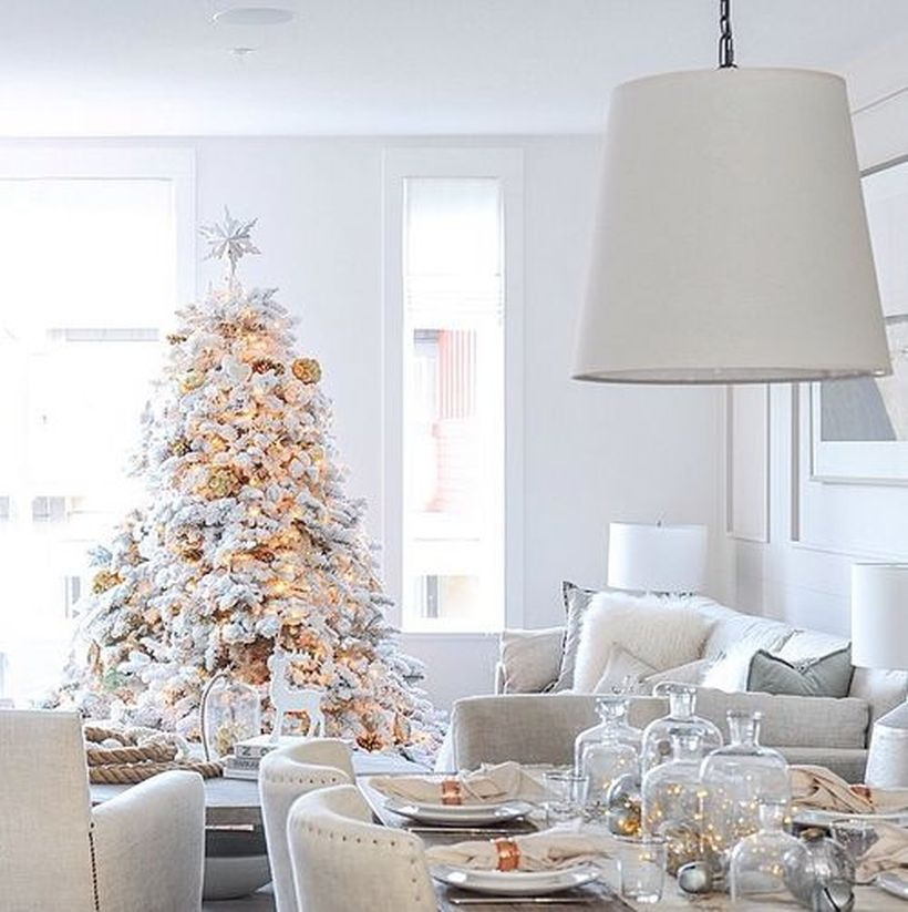 Glam-white-christmas-tree-with-decorative-lighting-and-gold-bell-ornament-for-decoration-your-living-room
