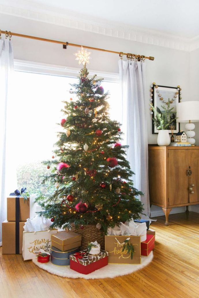 Green-chrismast-tree-with-red-bell-ornament-led-lighting-and-rattan-basket-for-chrismast-tree-conteiner