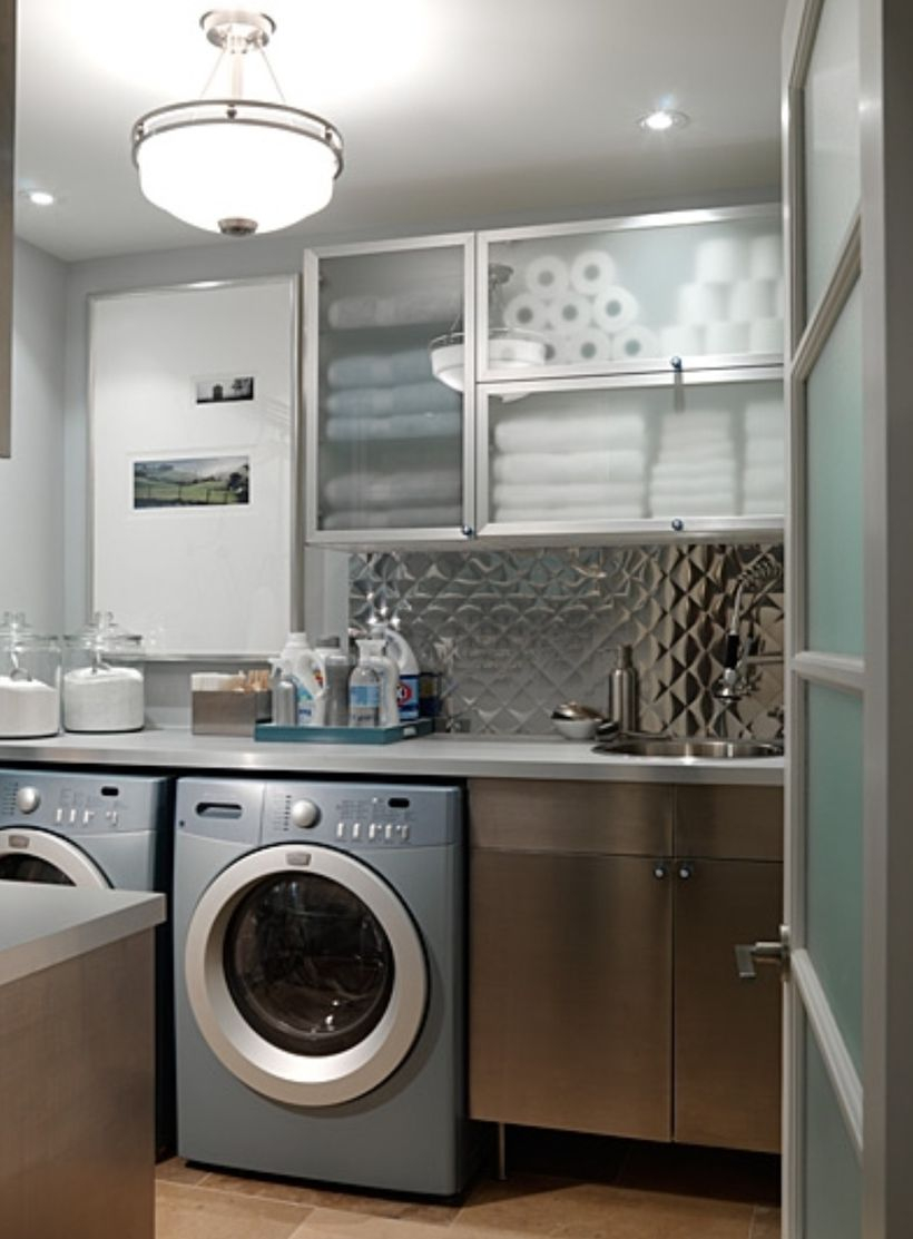 Laundry room with dark gray cabinet