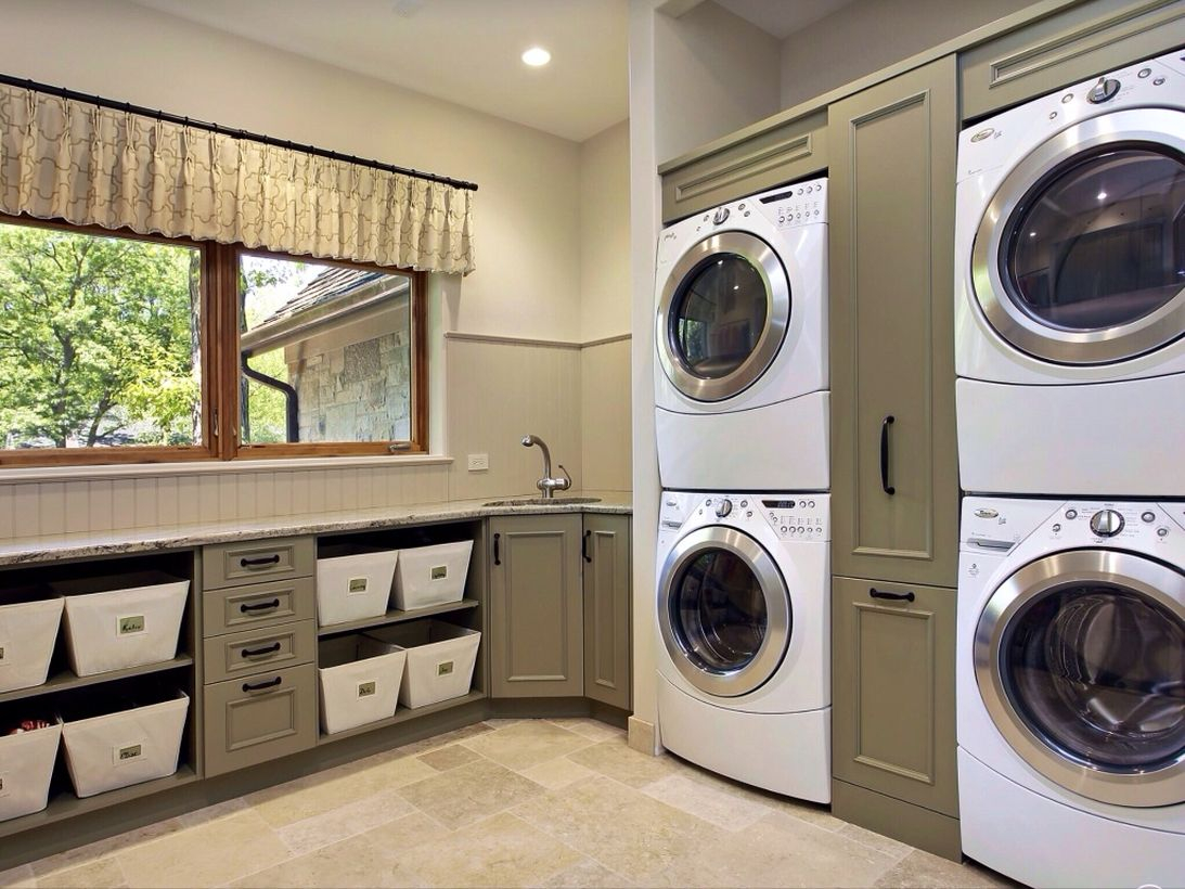 Laundry room with green cabinet and multi level washing machine