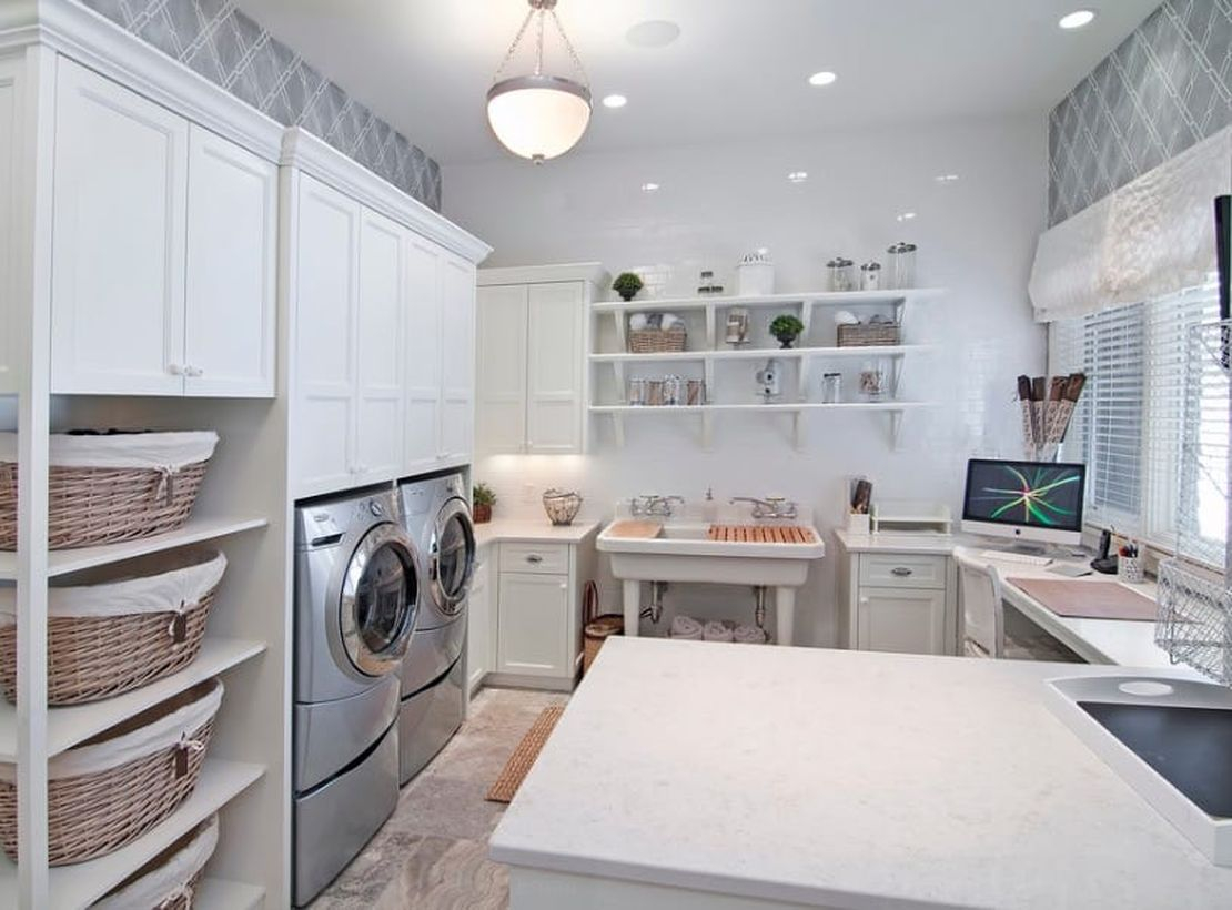Laundry room with multi level storage and white cabinet