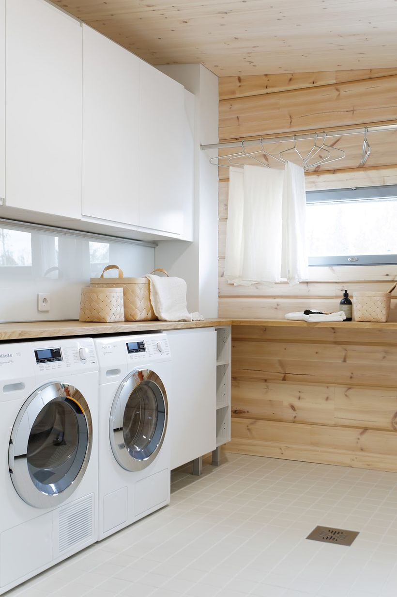 Laundry room with white cabinet and white washing machine