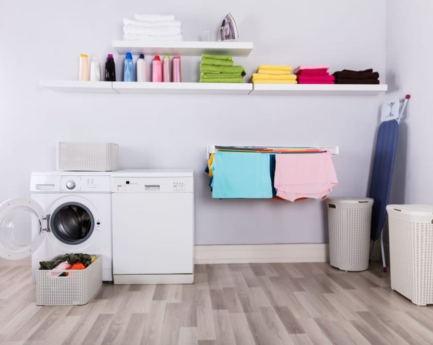 Laundry room with white rack and dtorage