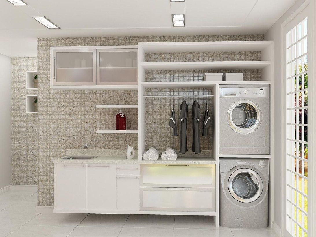 Laundry room with white white cabinet and white rack
