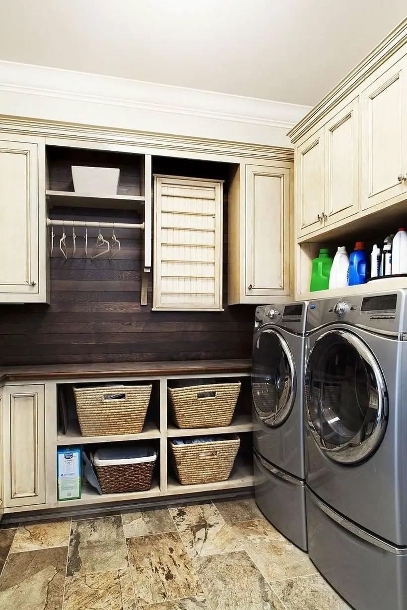 Laundry room wiyh white cabinet and gray washing machine