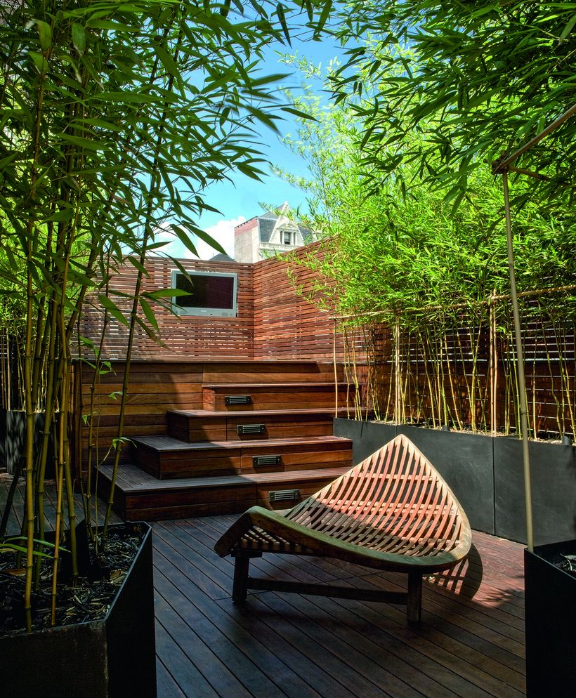 Minimalist-comfortable-rooftop-surrounded-by-some-greenery-will-make-it-cool-and-calm