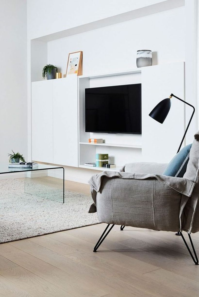 Minimalist-living-room-design-with-white-backdrop-tv-and-gray-sofa-to-relax-in-a-comfortable-family-room