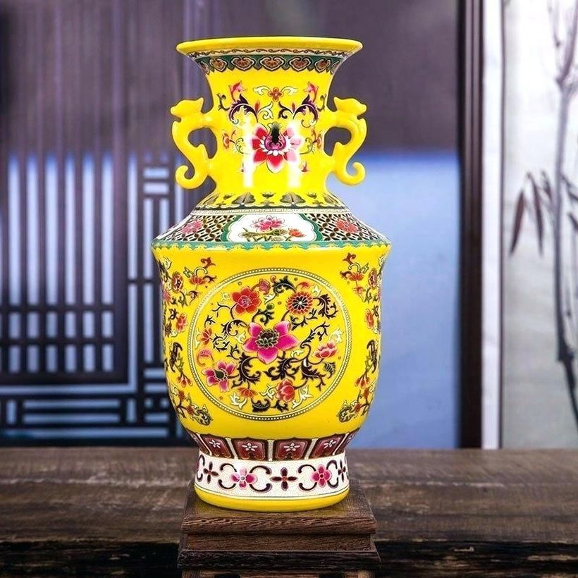 Modern-living-room-ornaments-yellow-ceramic-vases-with-unique-motifs-to-make-it-look-fancy-for-decorating-your-living-room