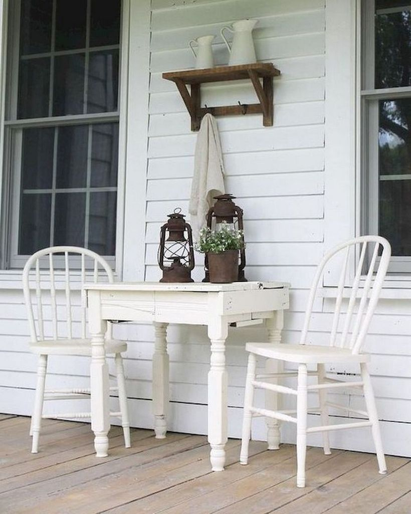 Proch with white wooden chairs and white wooden table