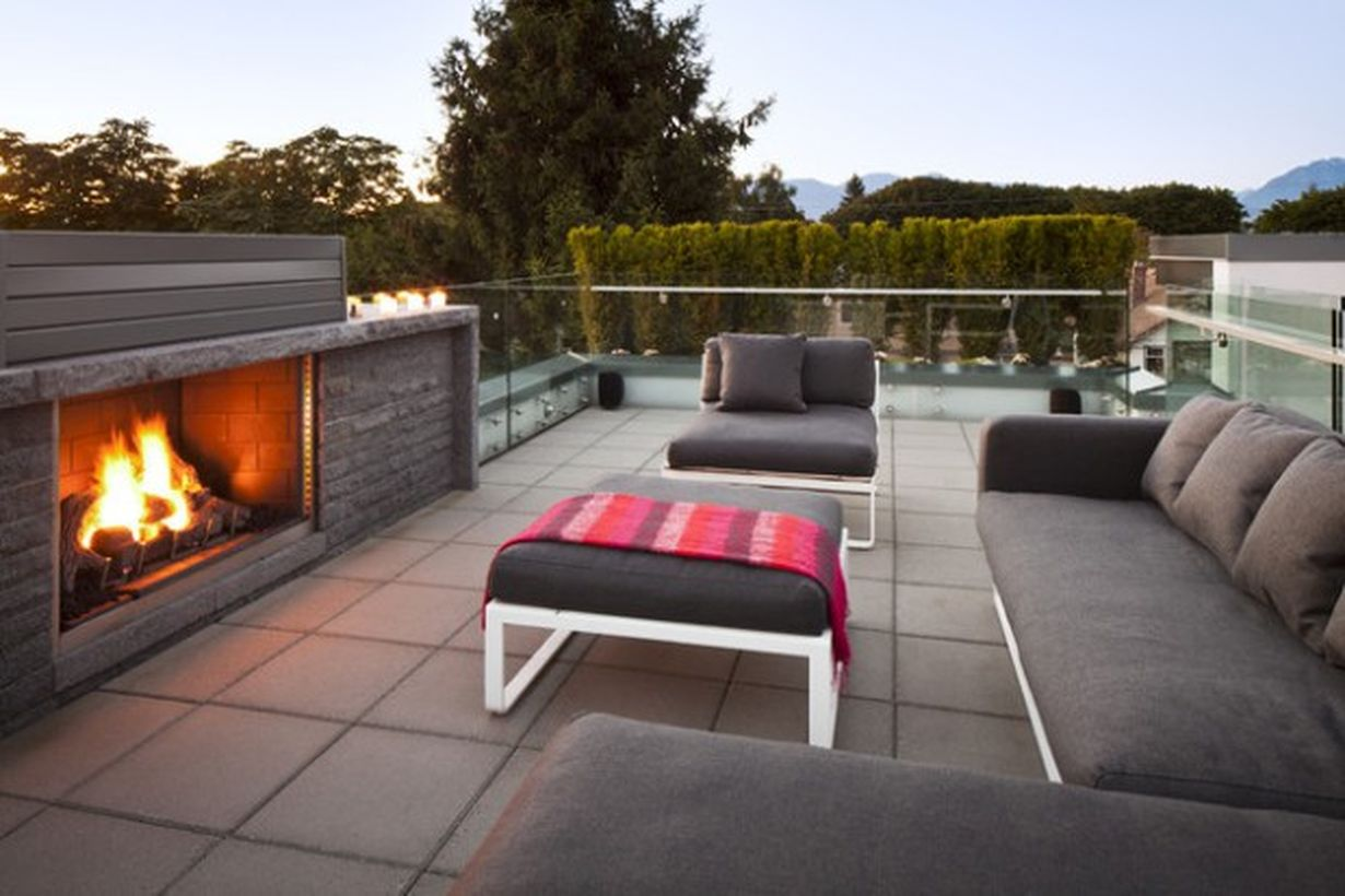 Simple-rooftop-designs-with-fire-pit-and-dark-gray-and-comfortable-white-frame-for-family-gathering