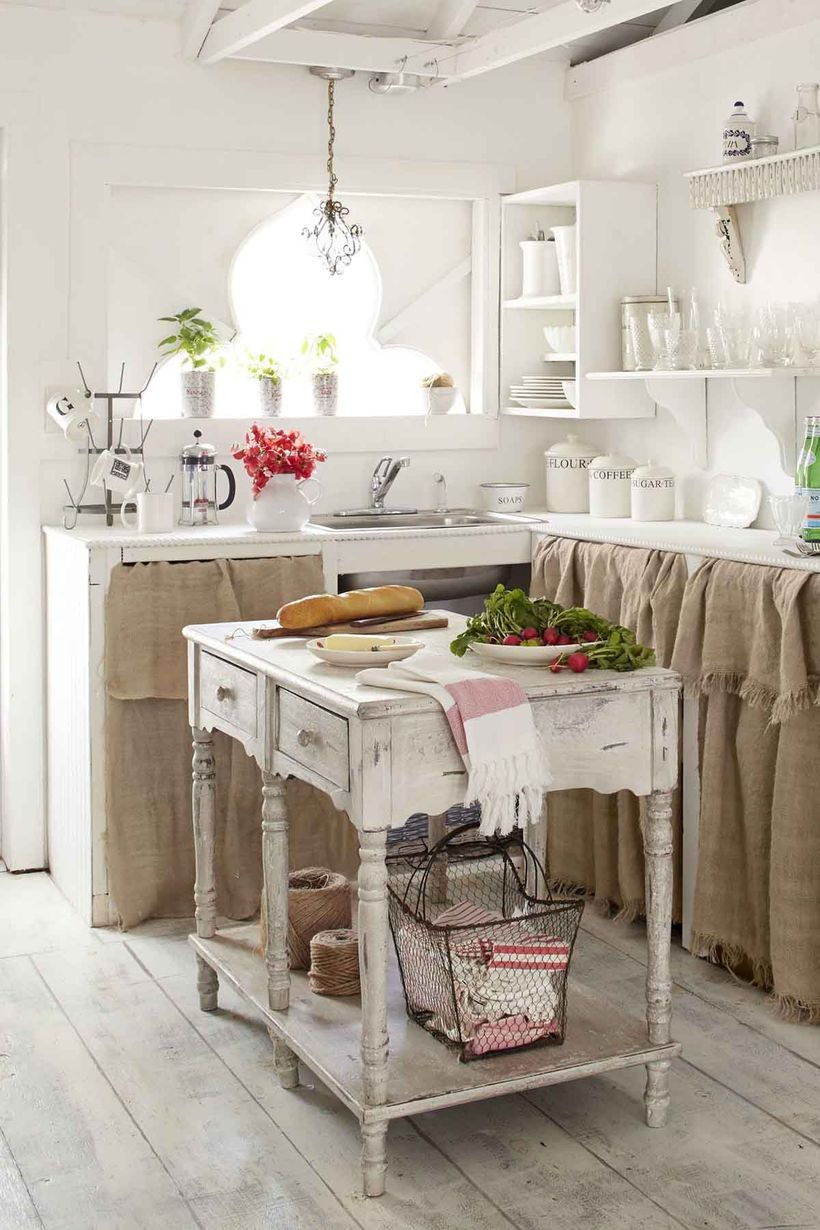Vintage-kitchen-design-with-wooden-kitchen-table-and-white-hanging-rack-to-store-plates-and-glass-cups