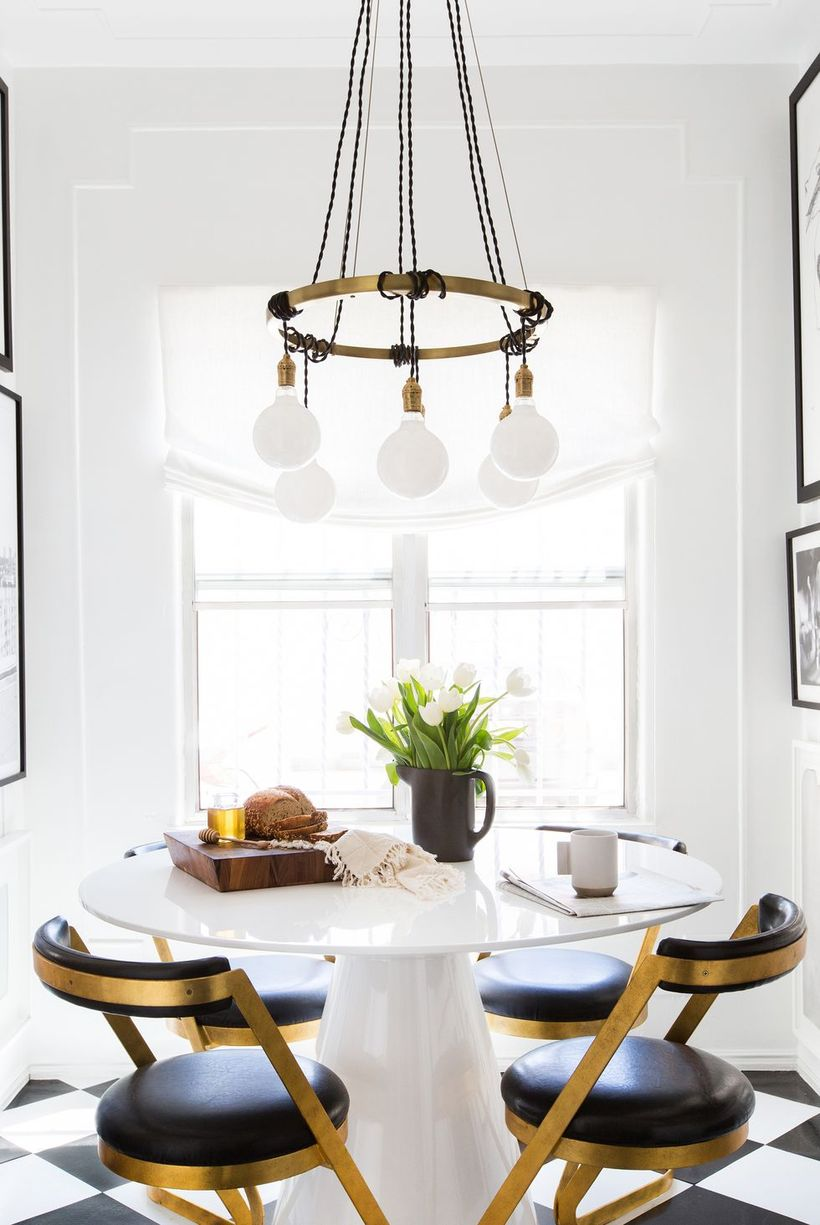 White-dining-room-design-with-round-dining-tables-unique-chandeliers-and-round-black-chairs-to-make-you-comfortable