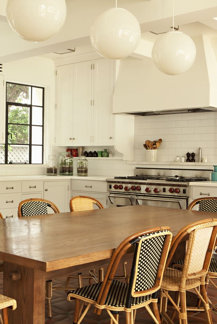 White-kitchen-decoration-presents-a-bohemian-theme-by-adding-rattan-chairs-and-hanging-lamps-with-a-shape-like-a-ball-for-your-inspiration