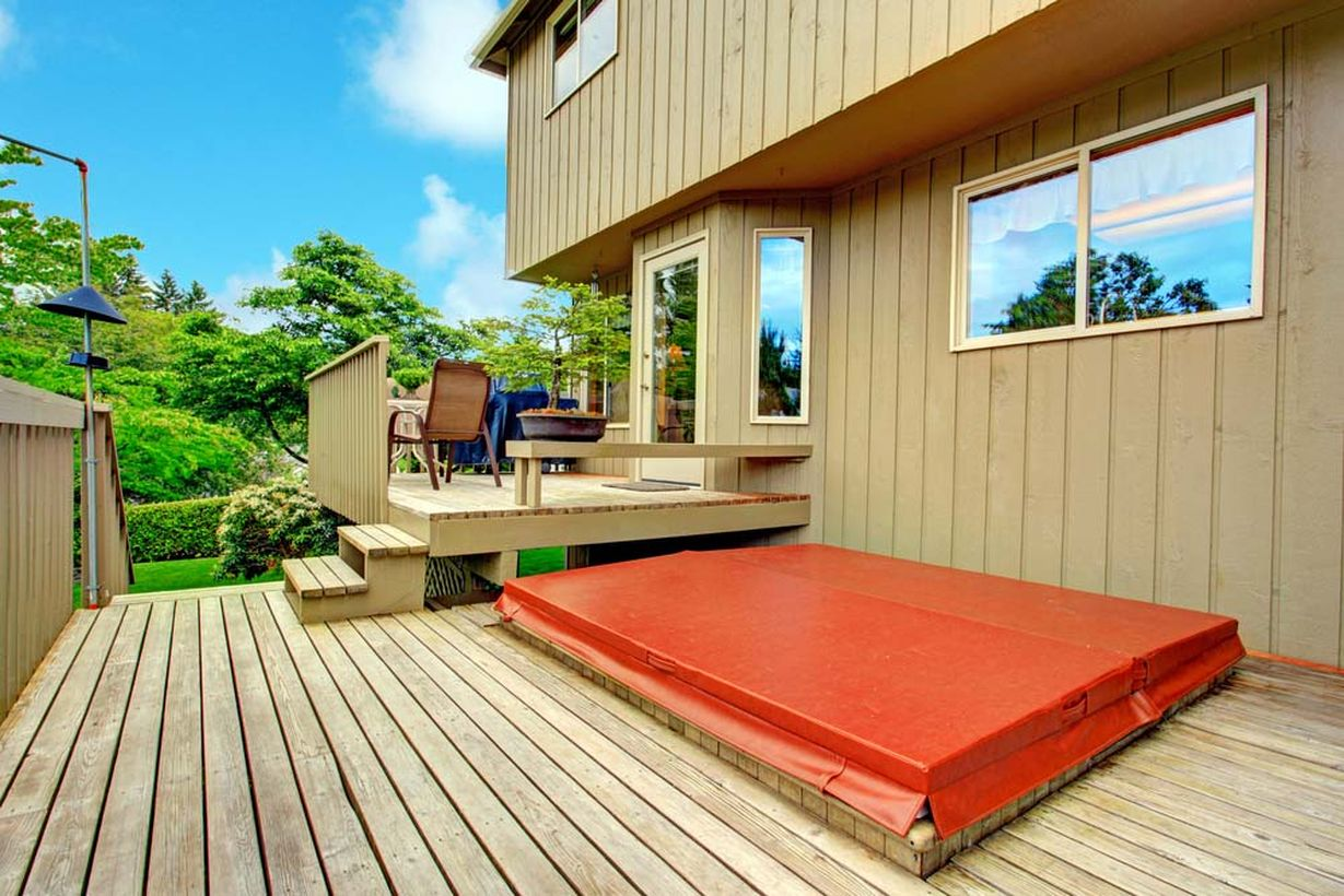Wooden-chair-and-long-bench-located-on-the-backyard-patio-deck-is-very-strategic-to-see-the-view