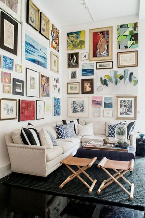 Against-the-backdrop-of-white-walls-and-black-floors-this-gallery-wall-is-an-inspired-way-to-create-a-room-full-of-color-pattern-and-energy.