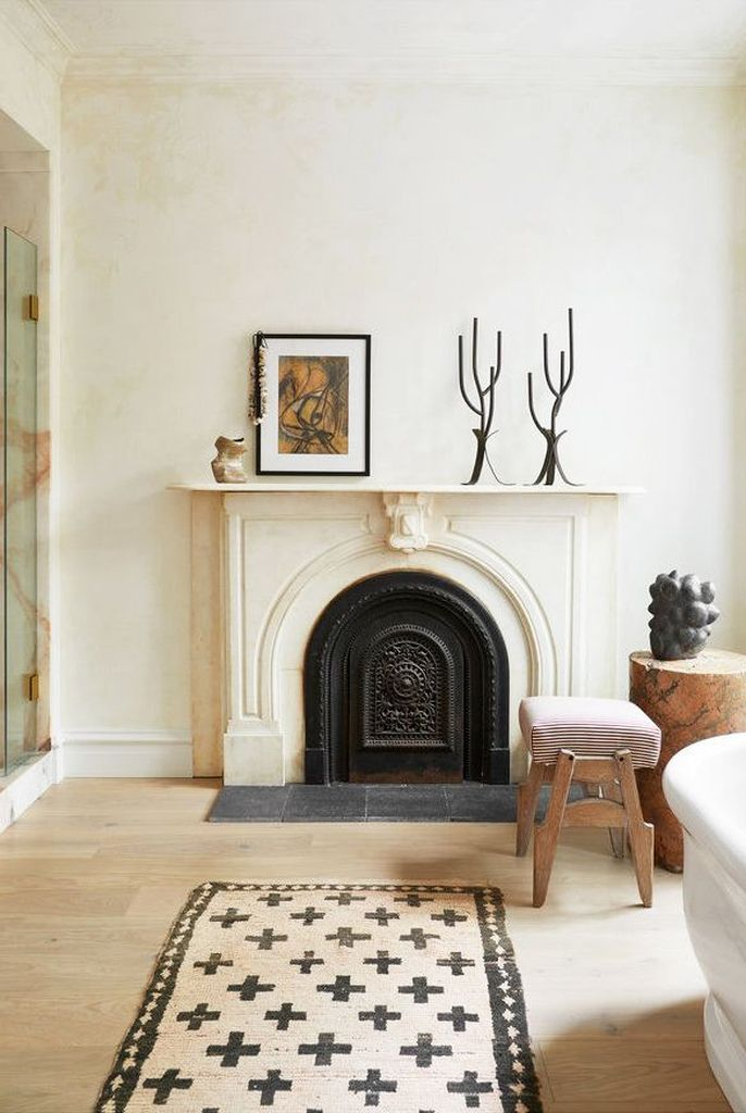 An elegant fireplace combined with candles and artwork