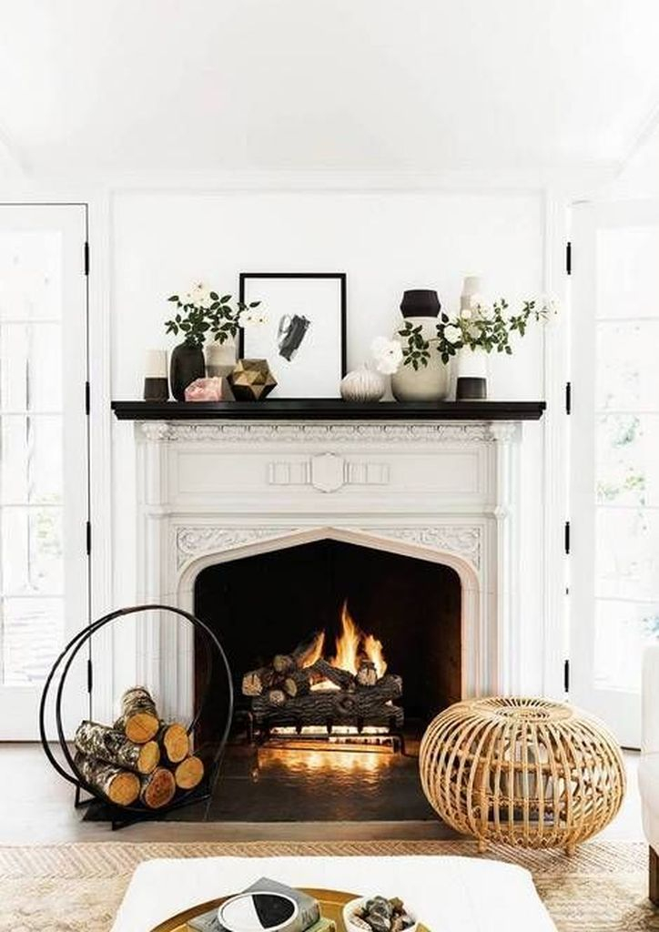 Black and white fireplace with plants decoration
