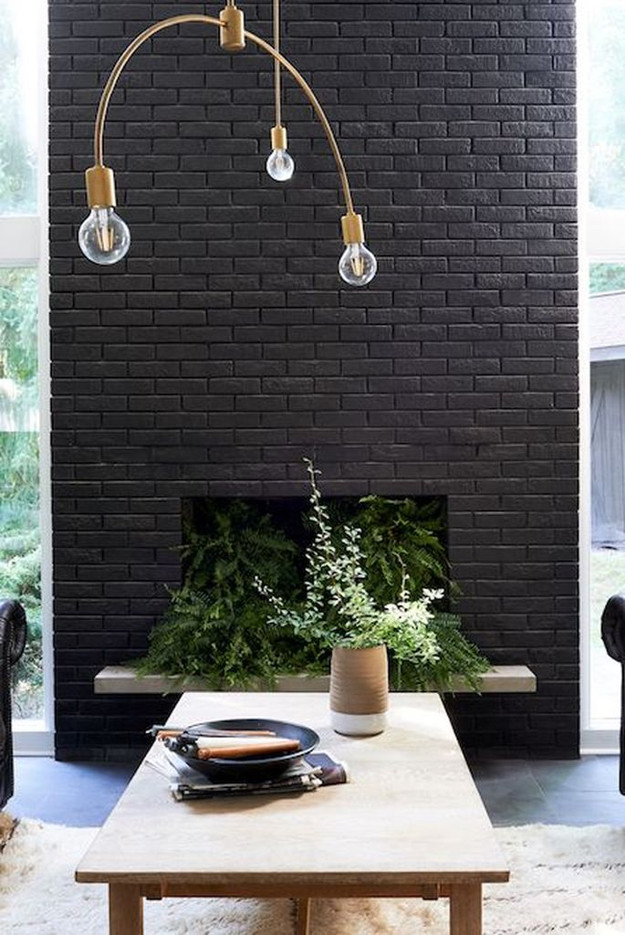 Black brick fireplace combined with greenery