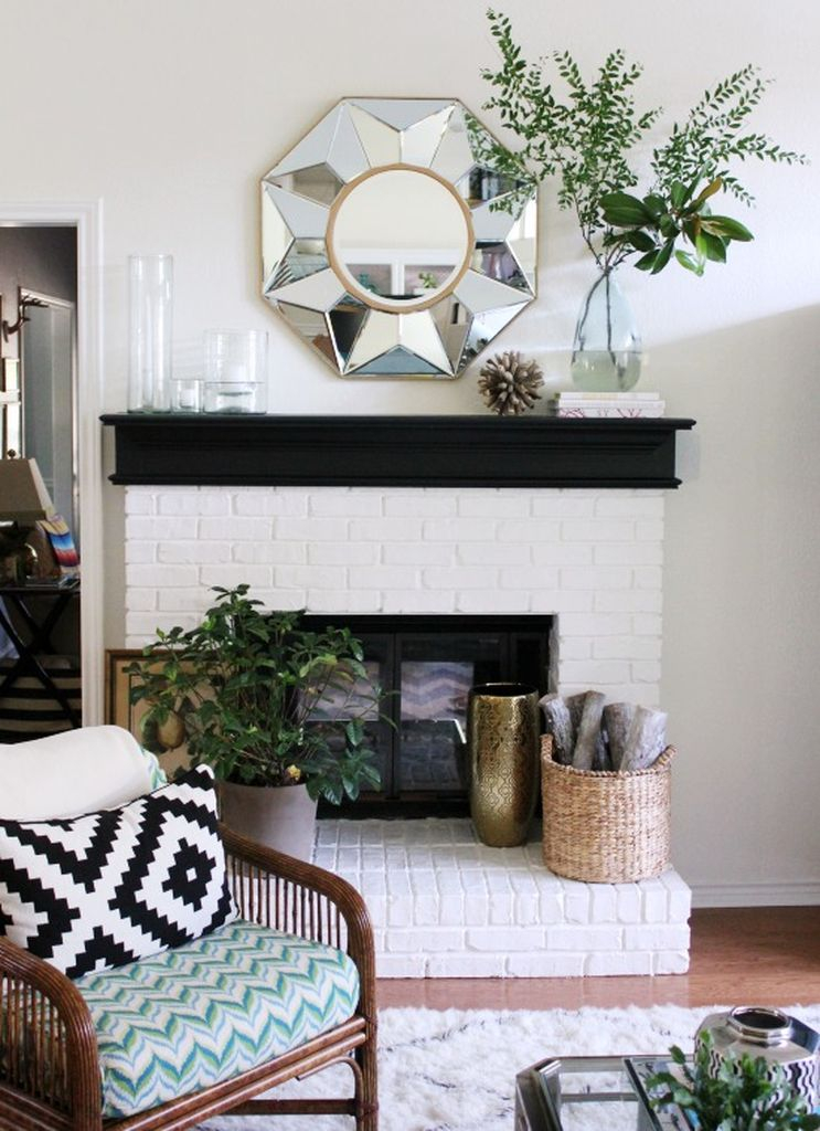 Brick fireplace combined with an elegant mirror above it