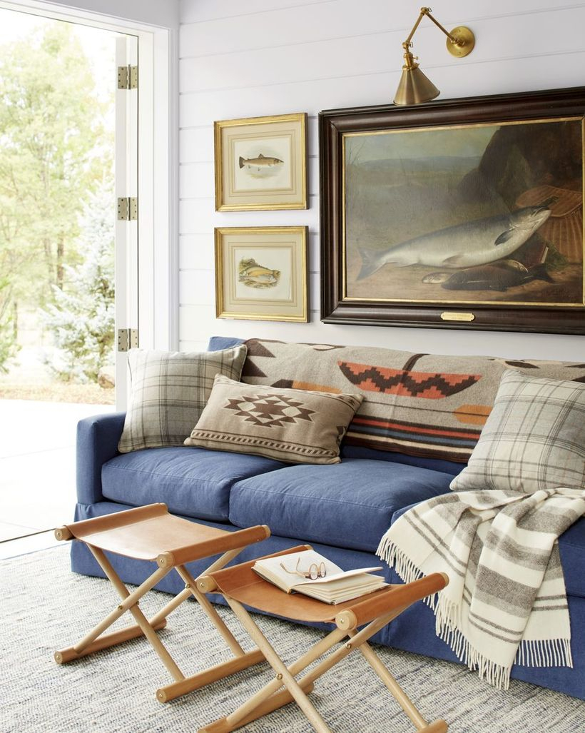 Classic and plaid motif in the gray cushion with blue sofa
