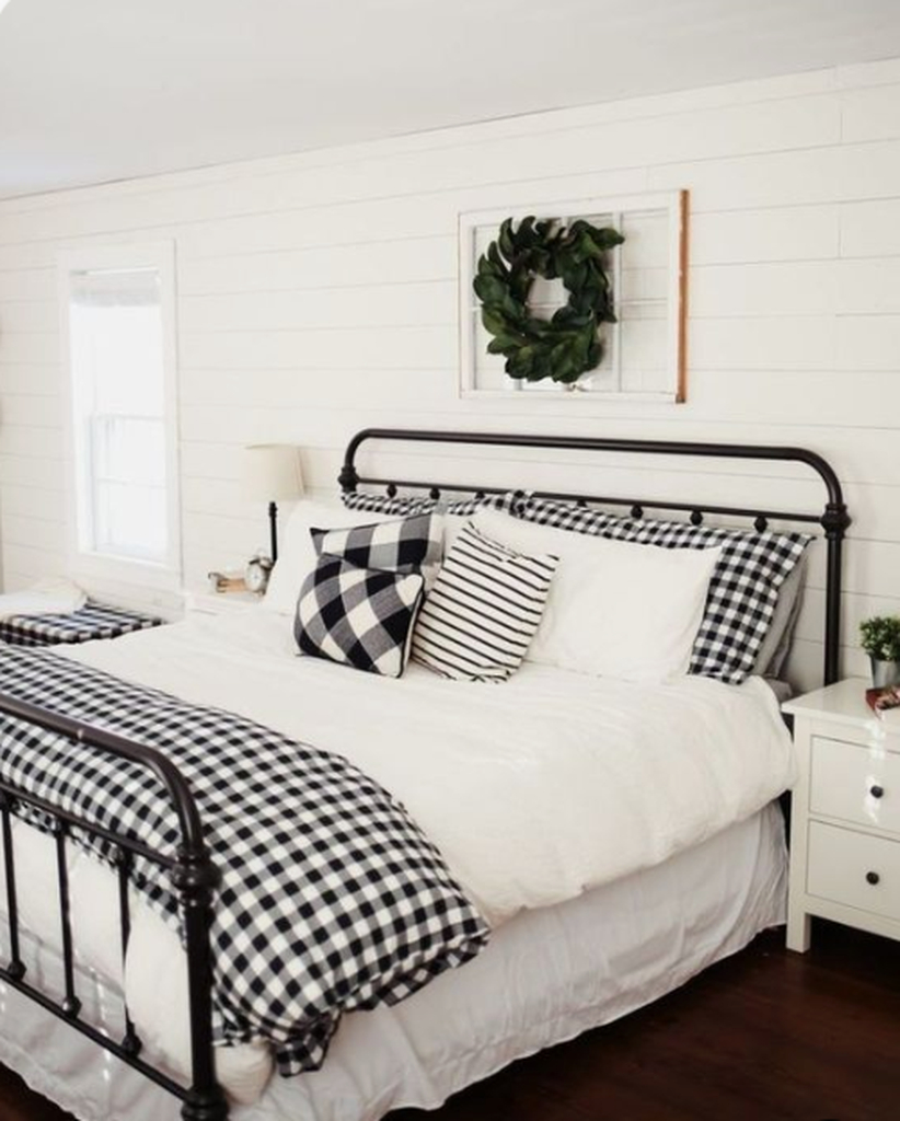 Classic bedroom with a fresh greenery wreath
