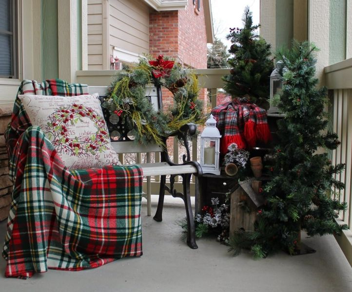 Decorate-the-balcony-with-an-outdoor-bench-laid-with-colorful-plaid-cushion-and-blanket.-you-can-even-place-a-wreath-at-the-opposite-end.