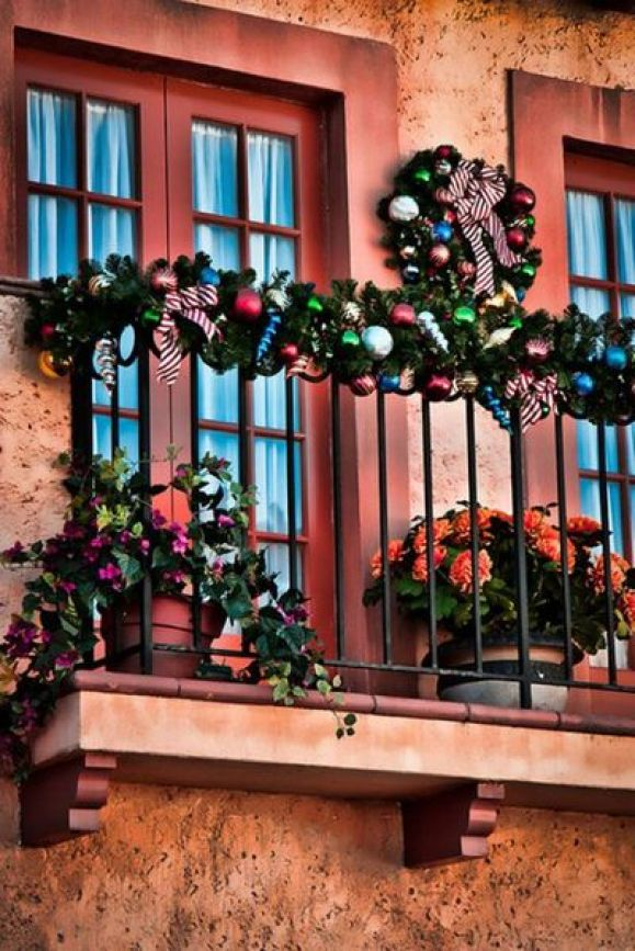 Decorate-the-balcony-with-beautiful-colorful-this-balcony-is-decorated-with-colorful-ornaments-garlands-and-wreath.