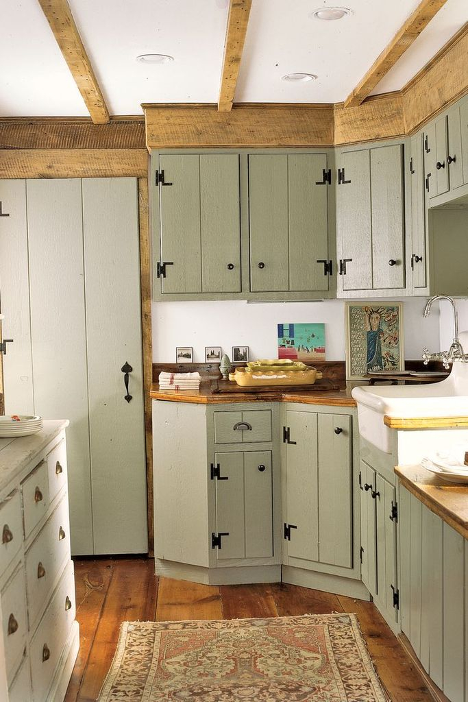 Farmhouse kitchen with green cabinets