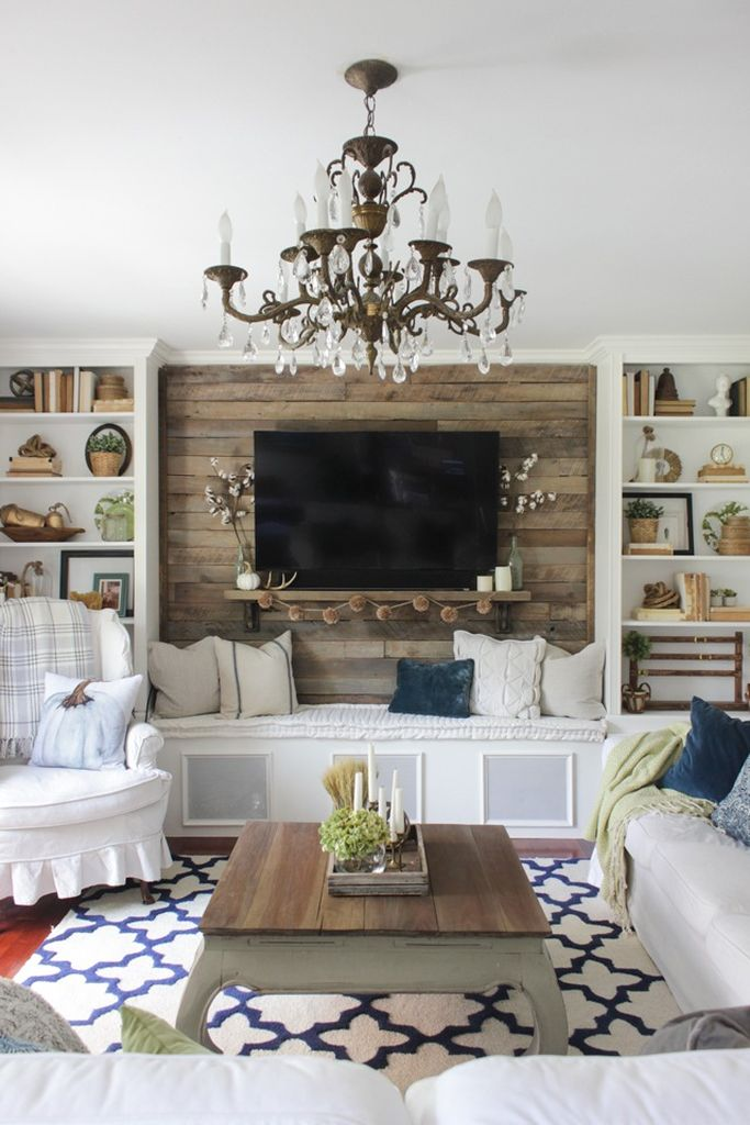 Farmhouse living room decoration in white with pine cones garland under tv to complete your beautiful living room