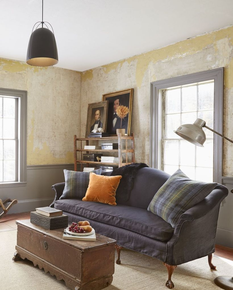 Gray plaid cushion with graysofa and square wooden table