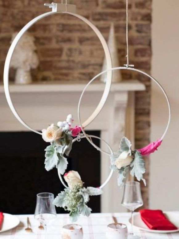 Hanging-wreaths-studded-with-a-few-seasonal-florals.