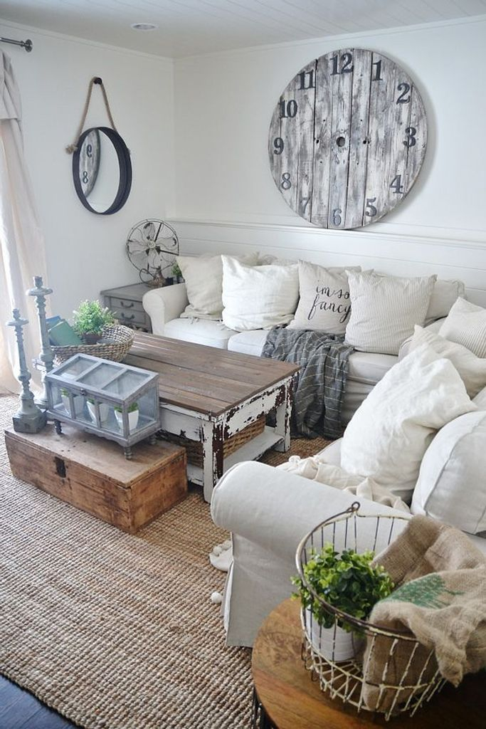 Simple farmhouse living roo design with vintage clock on the walls to perfect your living room
