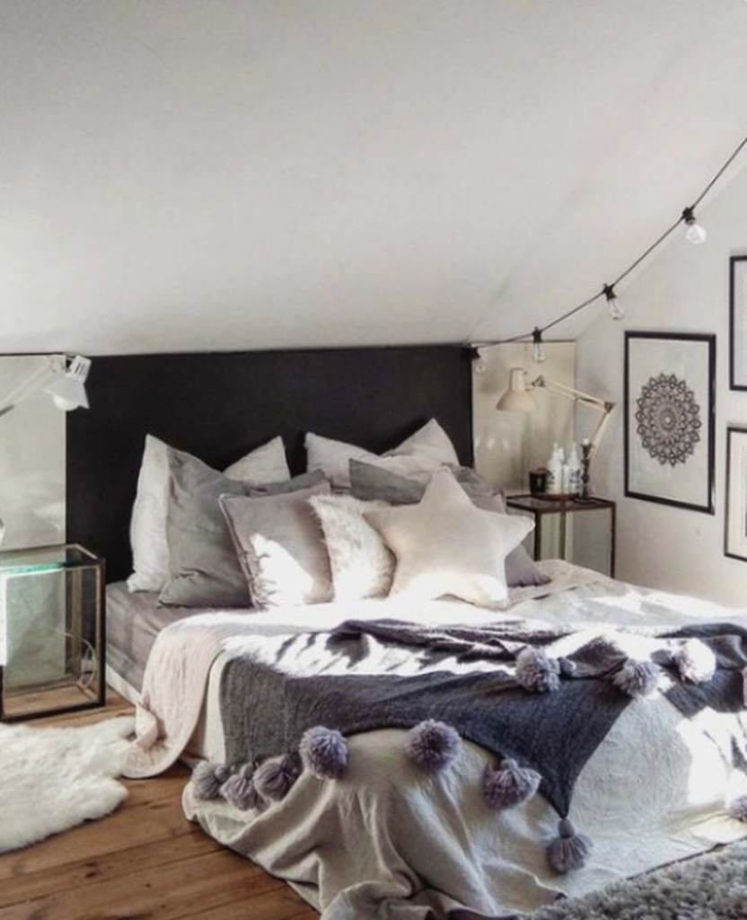 Small bedroom with string lamps