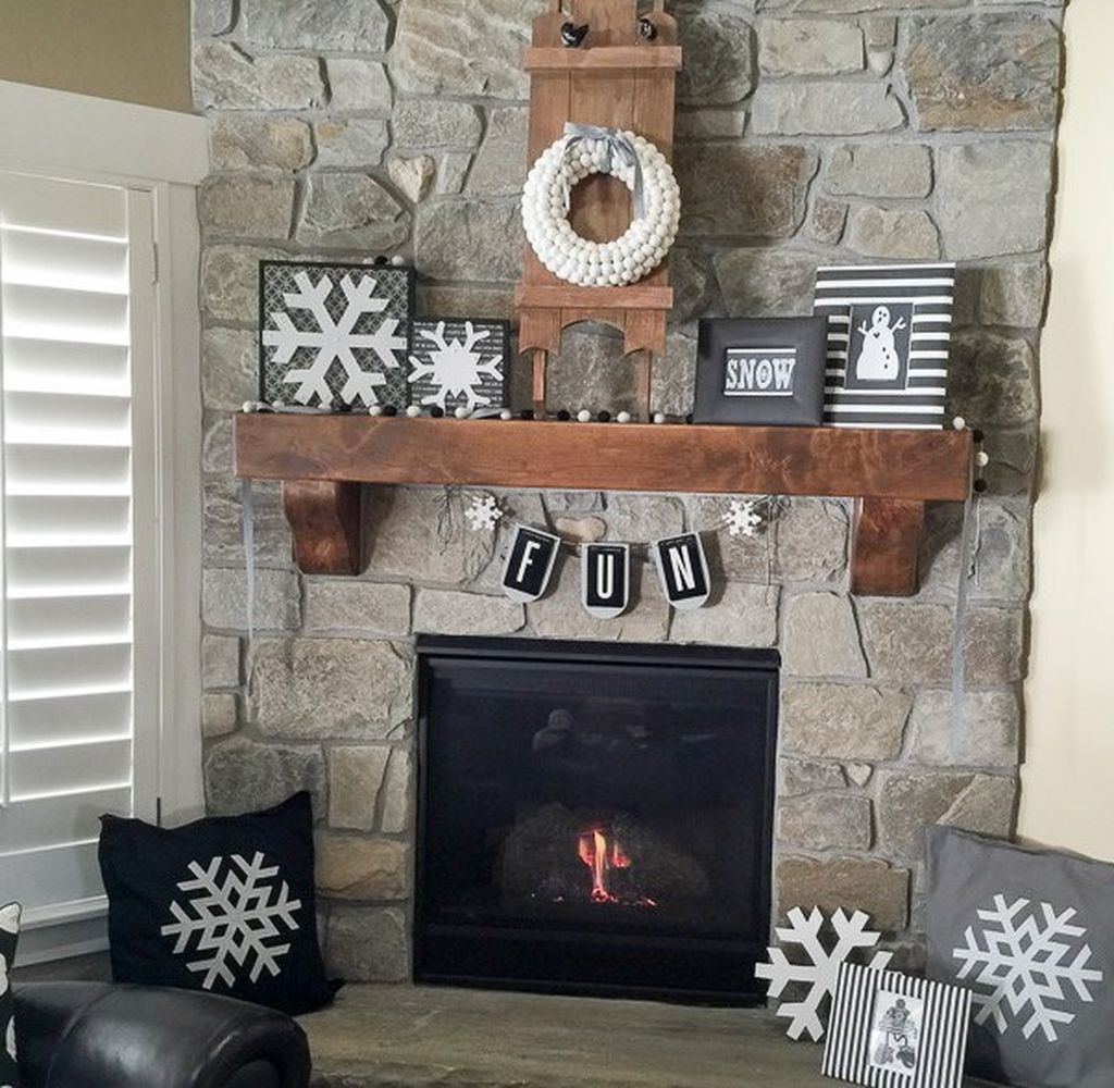 Stone fireplace combined with floating shelves above it