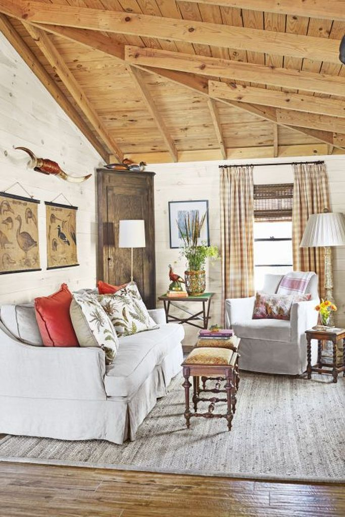 White sofa, small coffee tables combined with wooden closet at the corner to make more your an amazing farmhouse living room