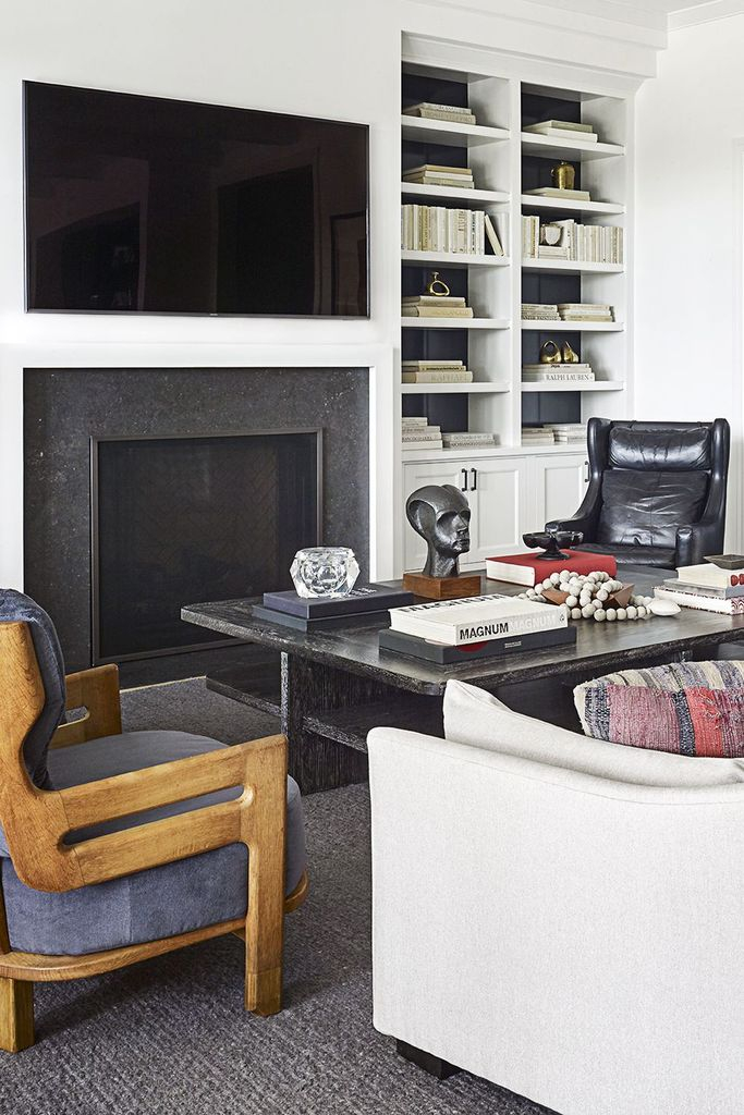 White walls combined with white shelves beside the tv