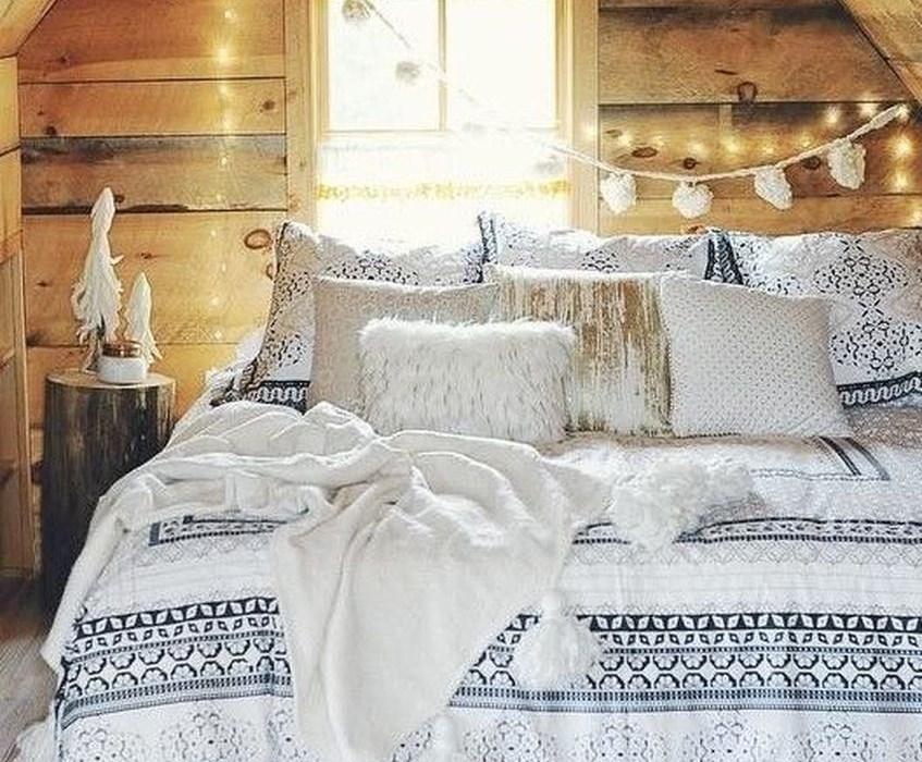 Winter bedroom all clad with rough wood