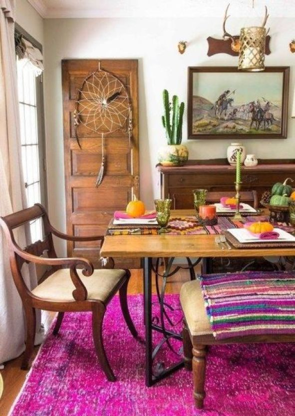 A-super-colorful-boho-dining-room-with-a-dream-catcher-elegant-wooden-furniture-potted-cacti-and-colorful-textiles