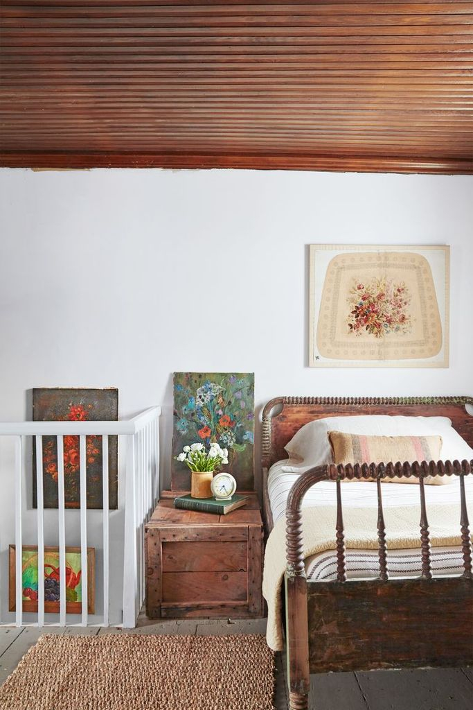 An antique wooden bed for farmhouse bedroom