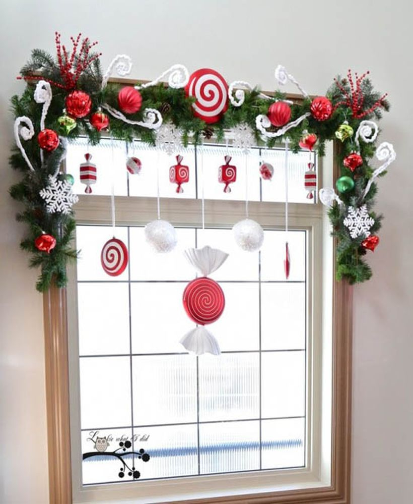 Christmas window with red and white canddy decoration
