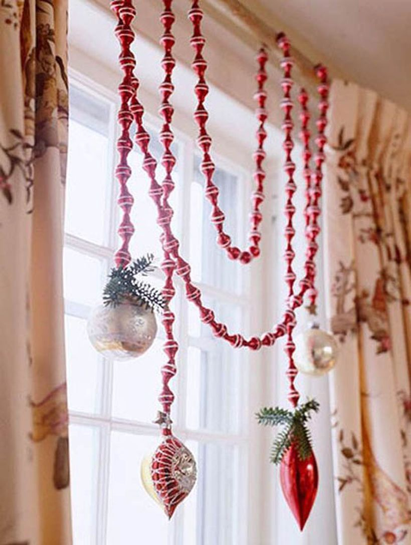 Christmas window with red and white hanging lamps