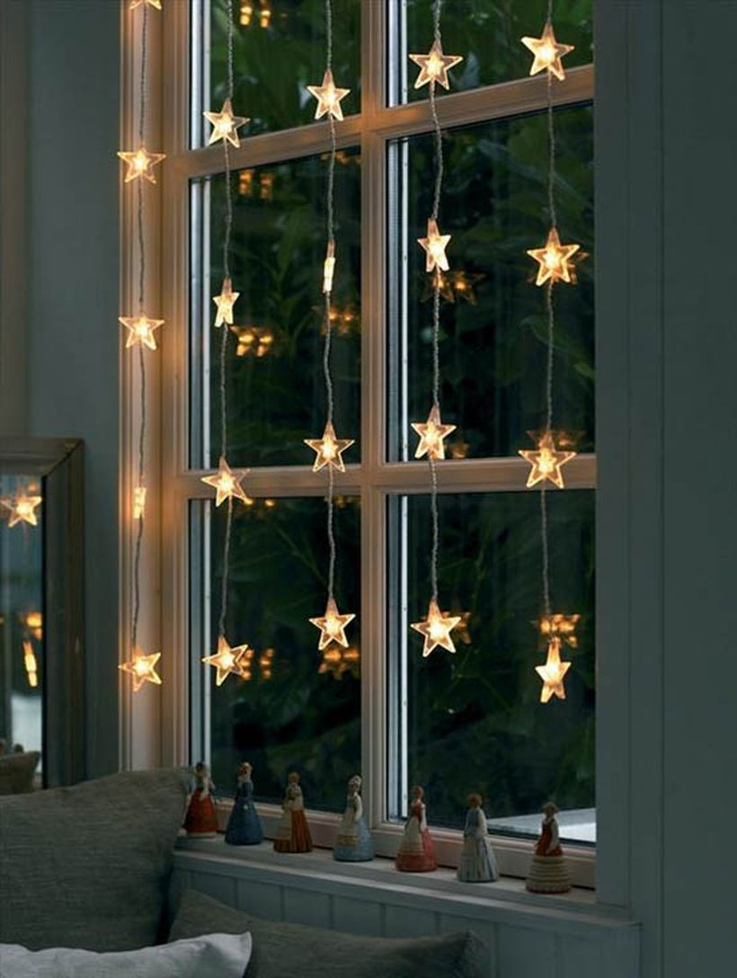 Christmas window with small star light decoration