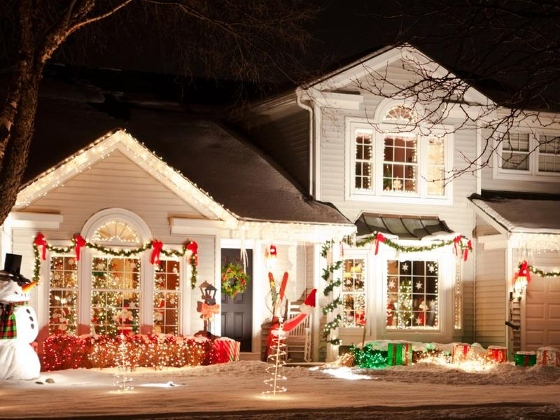 With-vibrant-lighting-garland-red-bows-wreaths-and-candles-in-the-windows.